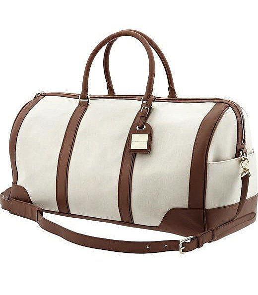 This Banana Republic Ines weekender bag ($298) has first-class traveler written all over it — we love the luxe pairing of creamy ivory and more masculine brown.