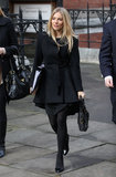 The silhouette has seeped its way into more than one piece of clothing category in the actress's closet: Sienna Miller was spotted in London in not only a fit-and-flare dress, but also a fit-and-flare black coat.