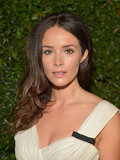 Abigail Spencer kept her makeup neutral with shades of cream on the eyes and a peachy lip color.