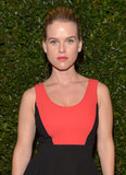 Alice Eve forewent flashy makeup and opted for a touch of bright lip gloss instead.