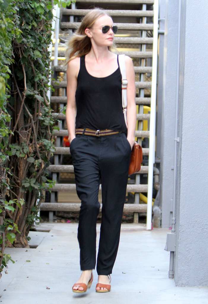 Kate Bosworth gave us another effortlessly cool ensemble in Beverly Hills in October 2012: a black tank, loose trousers, cognac sandals, and a striped woven belt.