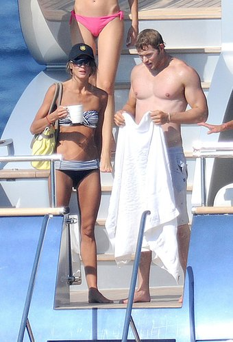 A shirtless Kellan Lutz spent time with his former girlfriend, Sharni Vinson, on a boat in St. Tropez in July 2012.