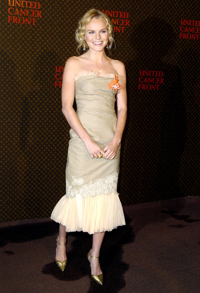 Kate chose a strapless ruffle-detailed confection and gilded pumps for the Louis Vuitton United Cancer Front Gala in Universal City, CA, in November 2004.