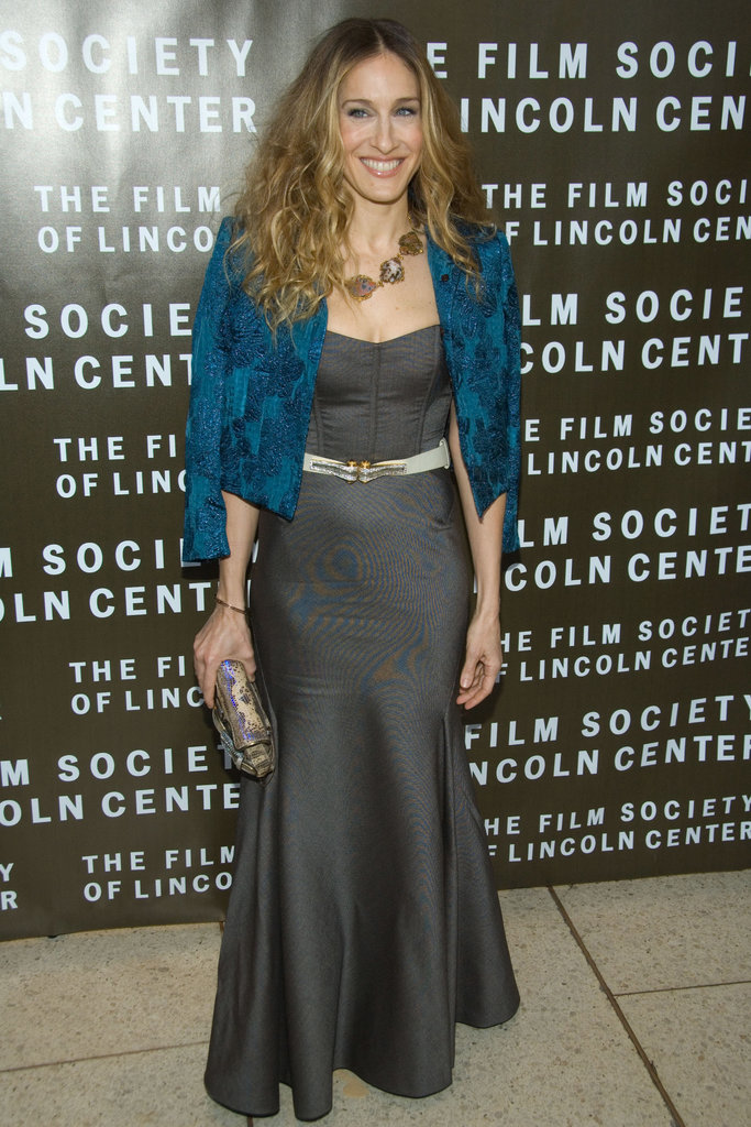 Parker swapped her signature minis for a charcoal trumpet-skirt Peter Soronen gown, lavish teal cropped jacket, and a gold-trimmed gemstone necklace in NYC.