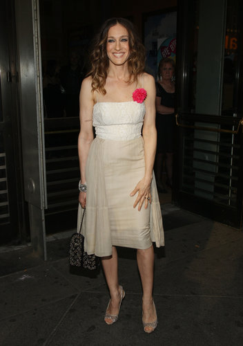 "SJP kept it ""casual"" in a lace-bodice dress, adorned with a hot-pink floral brooch, and sparkling accessories for the Broadway opening of The Philanthropist in 2009."
