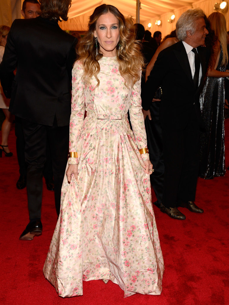 For the 2012 Met Gala, Sarah Jessica Parker chose a long-sleeved floral Valentino gown complete with matching pointy-toe pumps. Her gold cuffs, on both wrists, and silver drop earrings lent a touch of edge.