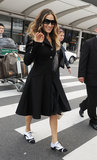 We love how SJP melded a feminine swing coat with borrowed-from-the-boys oxfords while arriving in Tokyo in March 2012.