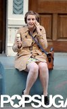 Lena Dunham chatted on a cell phone and ate an ice cream cone on the Girls set in NYC on Tuesday.