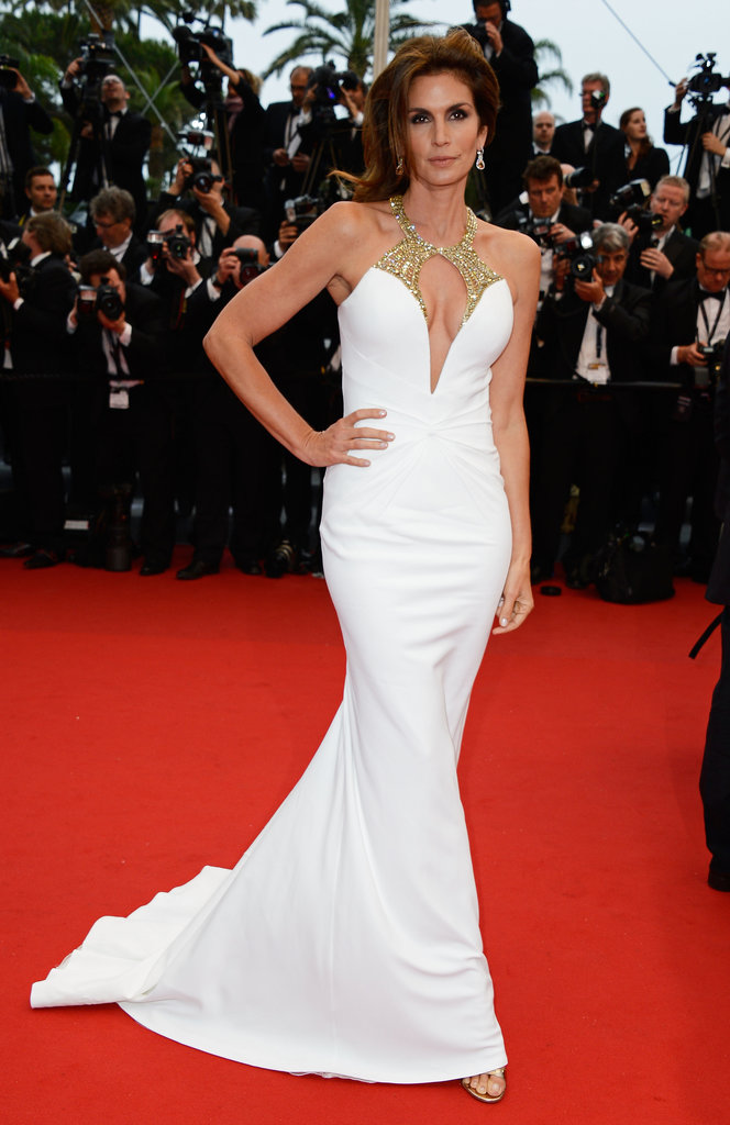 Cindy Crawford showed her curves off in a white gown with sparkling embellishment around its plunging neckline.