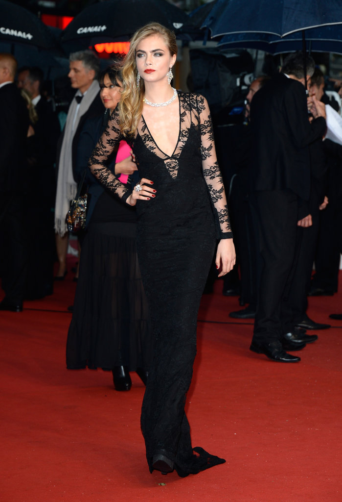 Cara Delevingne amped up the sex appeal in a body-con Burberry gown with a plunging neckline.
