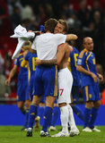 David Beckham hugged a player during the April FIFA 2010 World Cup Qualifier.