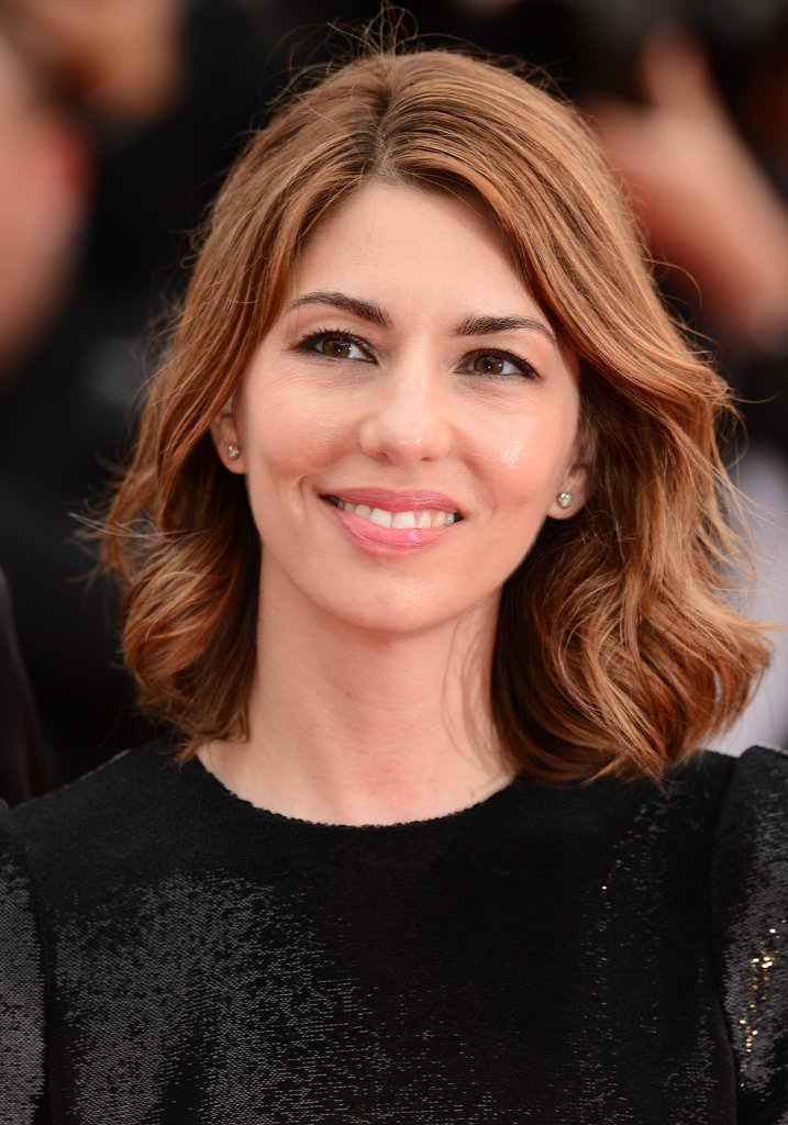 Sofia Coppola worked the Cannes red carpet for The Bling Ring with polished waves, defined eyes, and soft pink lips.