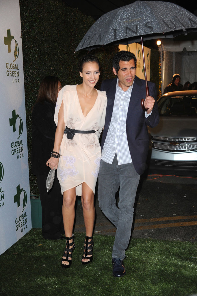 Cash Warren shielded Jessica Alba from the LA rain at a pre-Oscar party in March 2010.