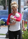 Britney Spears cradled her dog while out in LA.