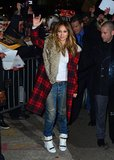 Jennifer Lopez braves the cold in this statement-making plaid and shearling overcoat.