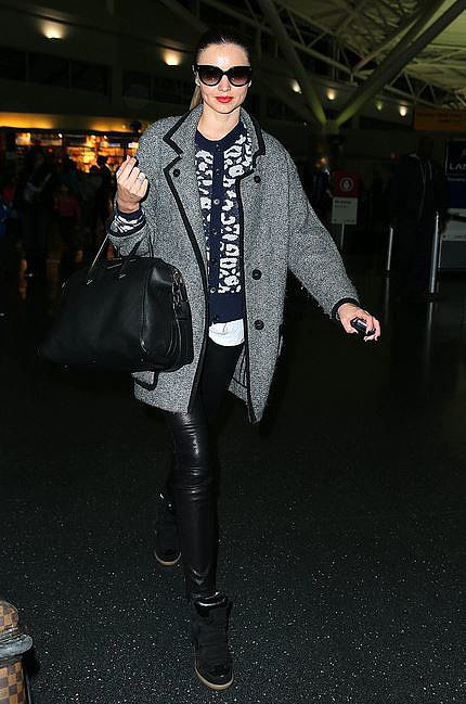 The ultimate model off-duty; Miranda Kerr. Her Isabel Marant coat adds a cosy layer to her leather skinnies + sweater combo.