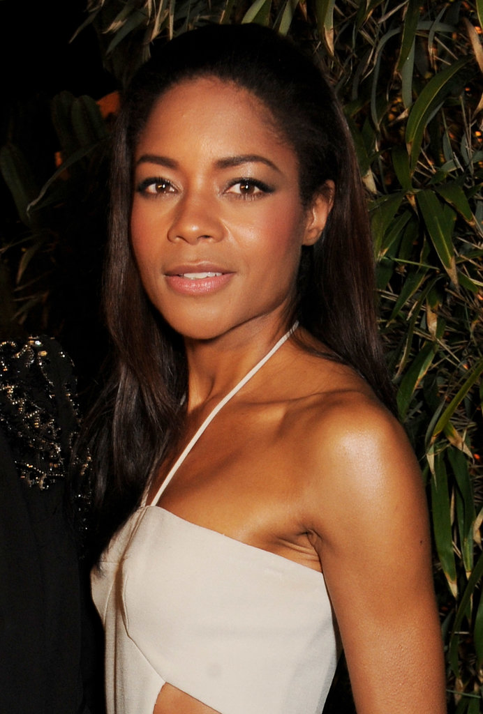 Naomie Harris wore her long hair slicked back in a cascading straight style.