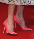 Patent pink heels finished off the cheerful ensemble.