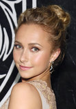 At the Versus Versace launch in New York, Hayden Panettiere wore her hair up in a textured bun. Her glowing makeup look focused on bronzed eye shadow and flirty lashes.