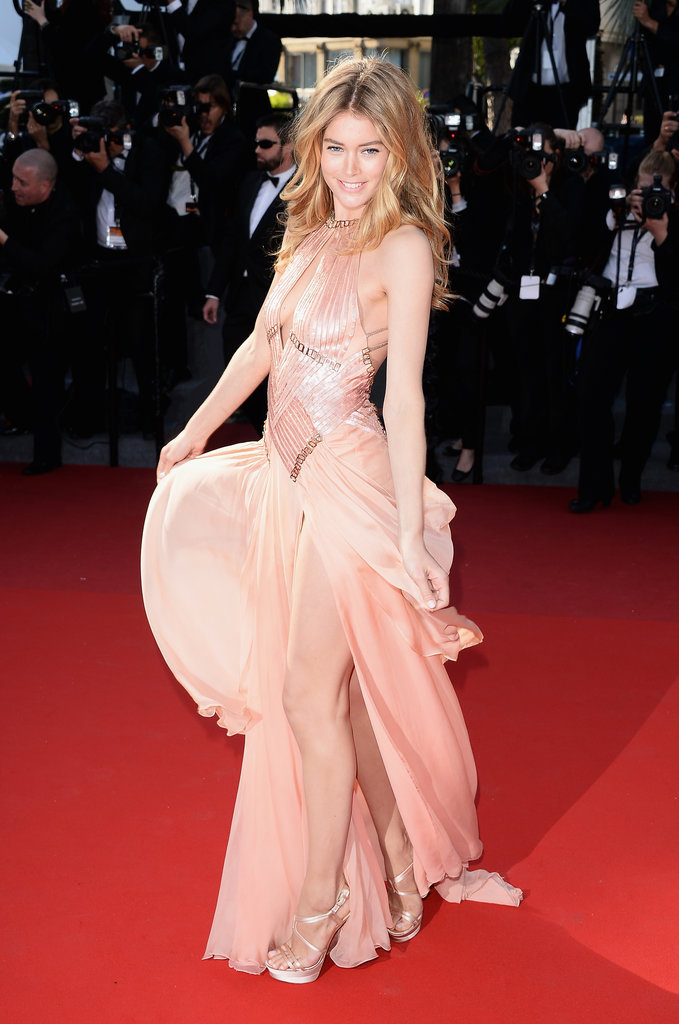 In the way of Cannes red carpet moments, this one is pretty major. Doutzen Kroes stole the spotlight at the Le Passé premiere in a peachy Atelier Versace gown.