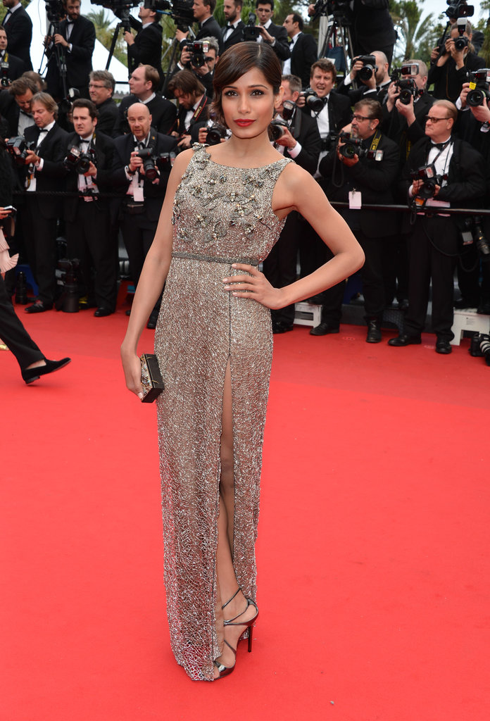 Freida Pinto lit up the Cannes red carpet in this embellished gown, a perfect red lip, and just a little leg.