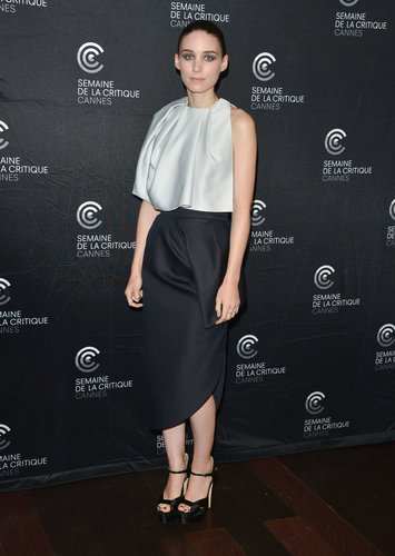 Rooney Mara donned a pale gray silk top and navy blue sculptural skirt, both by Dior, to the Ain't Them Bodies Saints premiere at Cannes. She added height with Brian Atwood platforms.