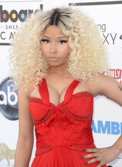 Opting for coiling curls, Nicki Minaj matched her red-hued manicure to her crimson dress.