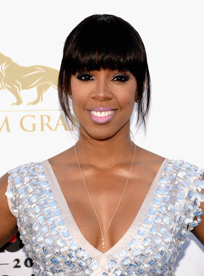 Bright pink lips were the highlight of Kelly Rowland's makeup look, while she styled her hair in a cute, undone ponytail.