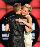 Justin Bieber hugged Miley Cyrus as he accepted his award.