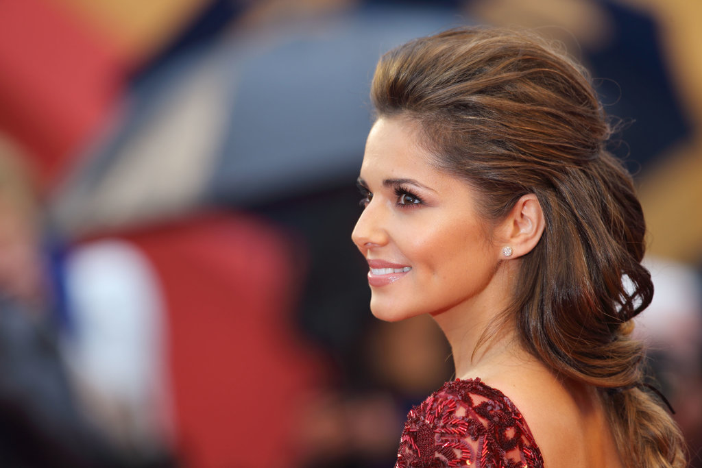 Cheryl wore smoky eyes that she paired with barely-there pink gloss,  bronzer and of course — false lashes!