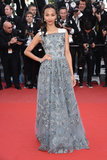 Zoe Saldana attended the premiere of Blood Ties in a Valentino gown featuring a decadently embroidered gunmetal-gray overlay.