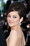 Marion Cotillard wore a beehive hairstyle that was high on volume — vintage brides, take note.