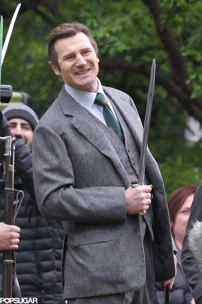 Liam Neeson was all smiles wielding a sword, naturally.