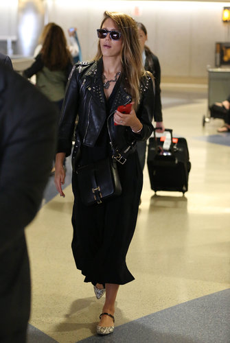 A leather jacket isn't likely to look as cool with your sweatpants as it does with Jessica Alba's just-as-comfortable day dress and snake-print flats, and Carrera sunglasses.