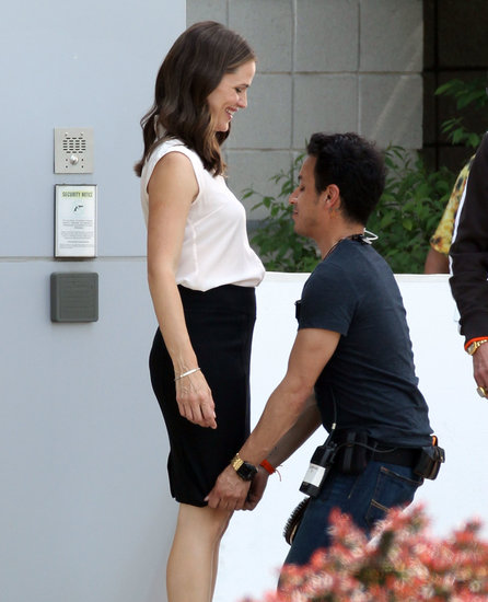 Jennifer Garner got help adjusting her pencil skirt on set on Monday.