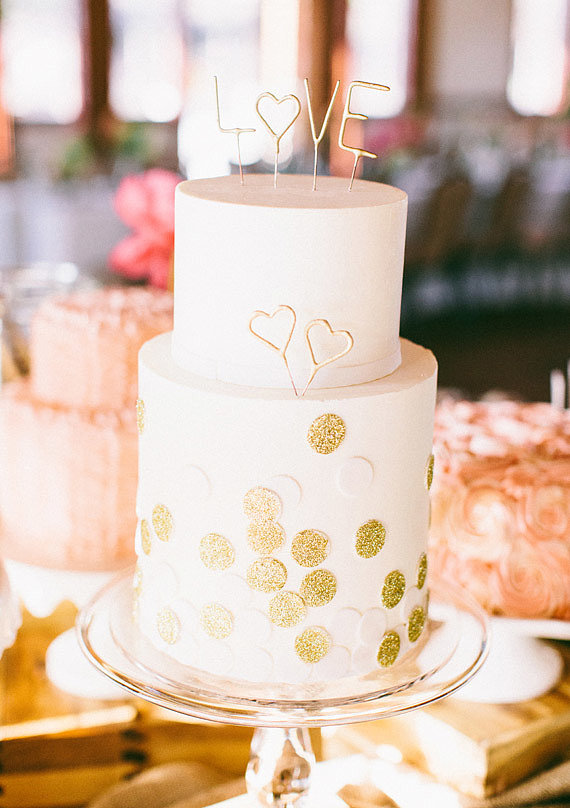 "Decorate your cake with gold dots and letters that say ""love,"" and it'll instantly be one for the books.  Photo by Ciara Richardson via 100 Layer Cake"