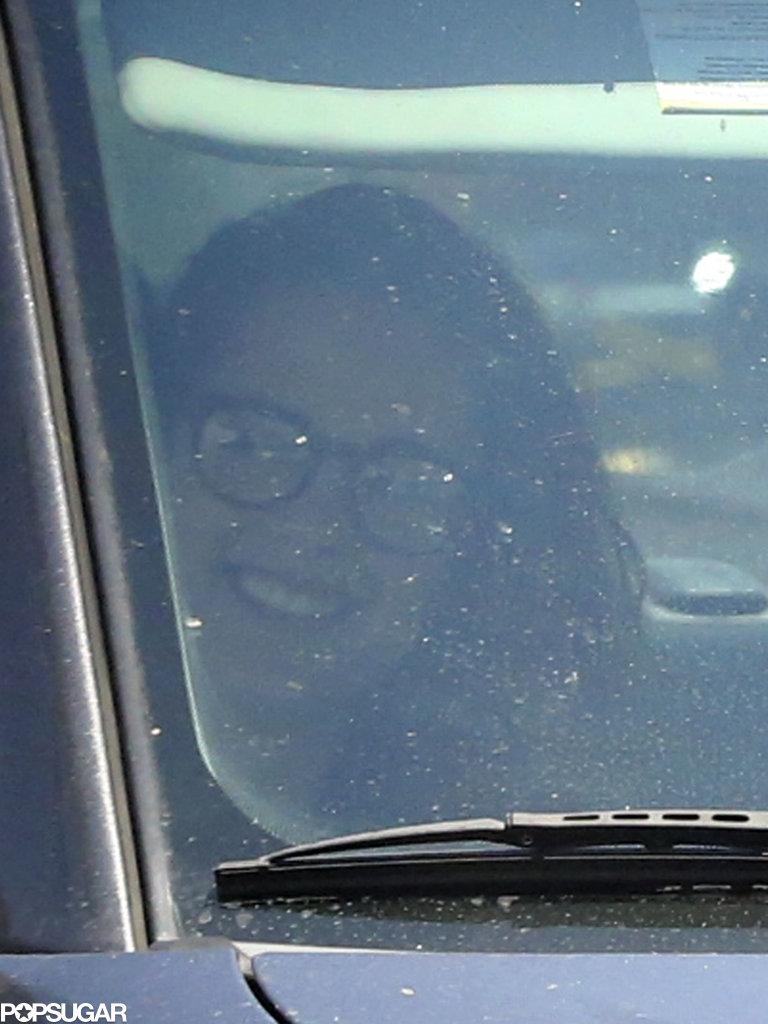 Kristen Stewart smiled in the passenger seat.