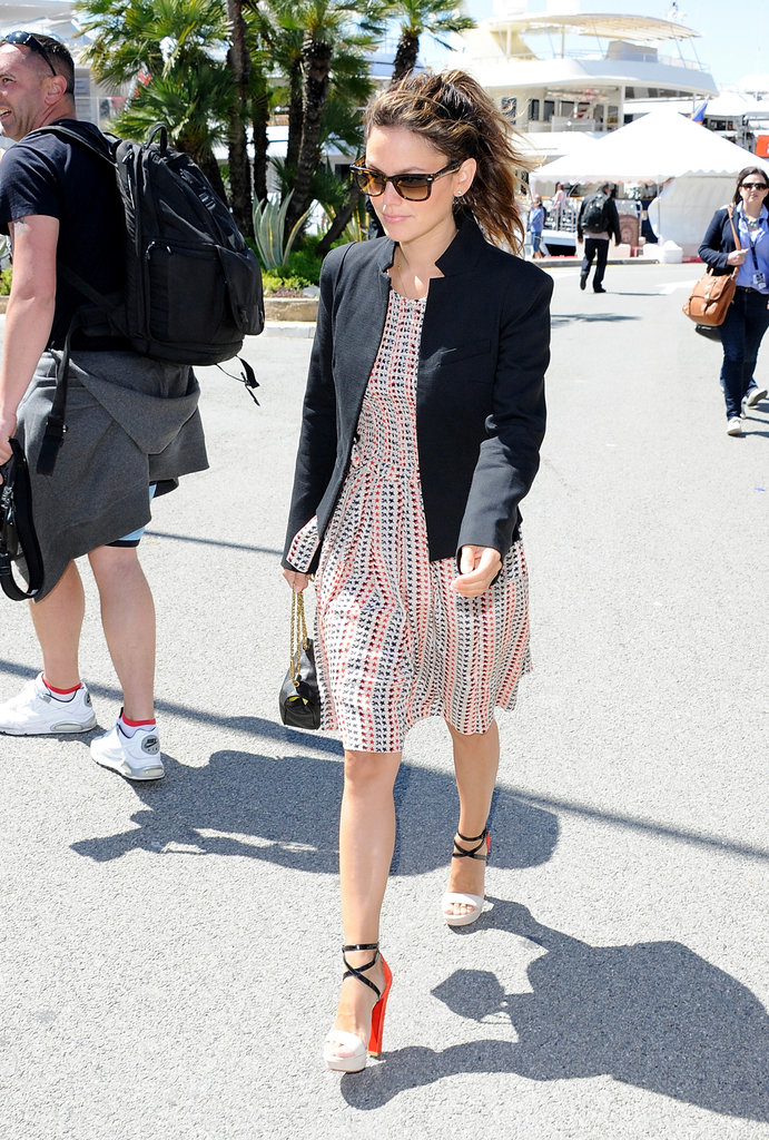 Rachel Bilson lent polish to her printed dress via a collarless black blazer, then added height with a pair of colorblocked platform sandals while on the go in Cannes.