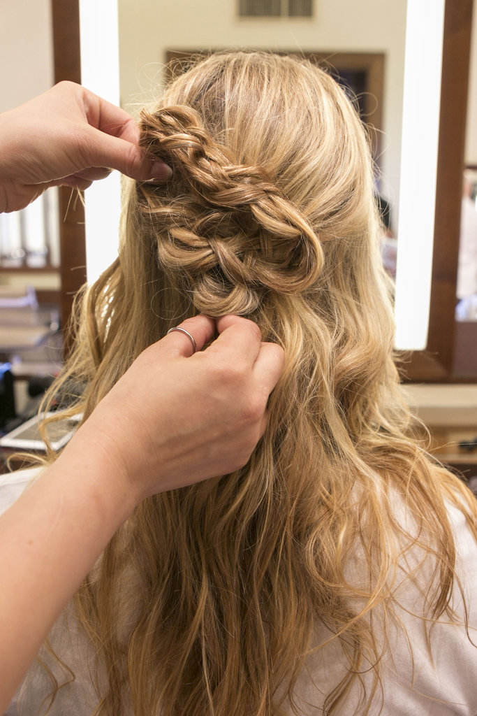 Be certain to grab some hair from the right and pin it along with the braided shape to form a half-up style. Then, secure the braids into place.