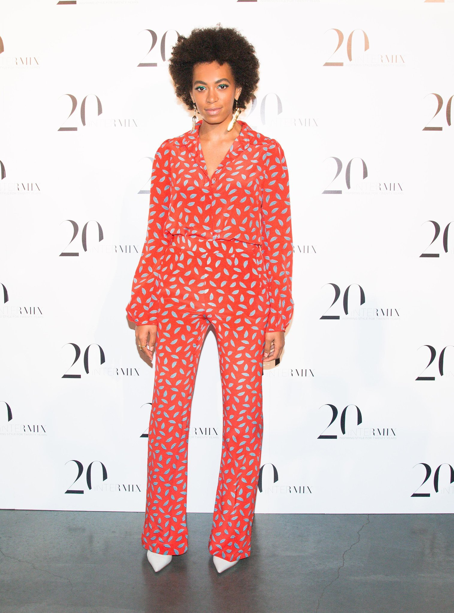 Solange Knowles wasn't afraid to show off her love for prints in a Diane von Furstenberg blouse and matching pants, completed with white pumps, at the Intermix 20th anniversary party in NYC.  Source: Benjamin Lozovsky/BFAnyc.com