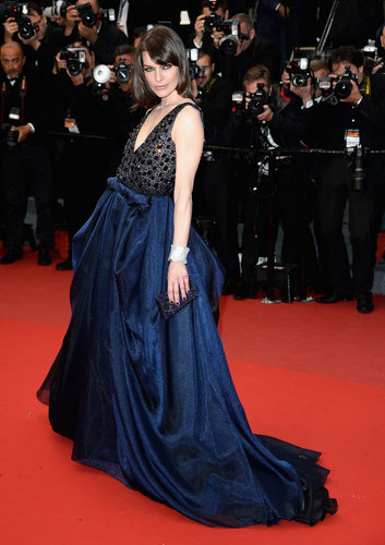 Milla Jovovich delivered dark glamour in an embellished navy Armani gown at the All Is Lost premiere.
