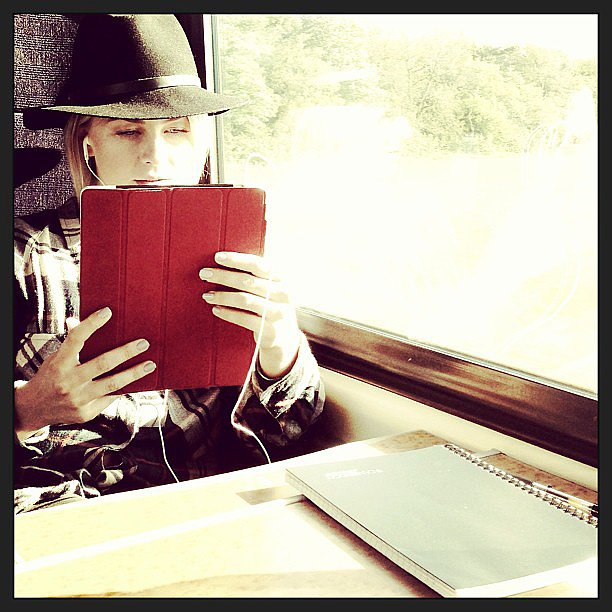 Julianne Hough relaxed with some reading material during a train ride. Source: Instagram user juleshough