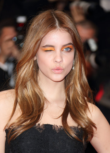 Model Barbara Palvin wore bright orange eye shadow from lash line to brows at the All Is Lost film debut.