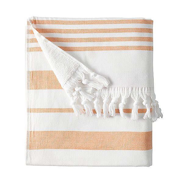 While this Fouta Beach Towel ($48) is absorbant enough to dry you off after a swim, you'll want to keep it wrapped around you as a beach cover-up.