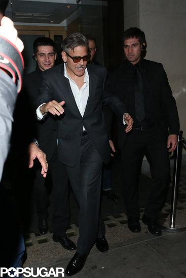 George Clooney appeared to trip over his own two feet leaving Nobu restaurant in London.