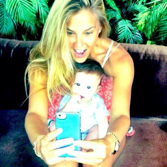 Bar Refaeli was happy to take a photo with a young friend in May 2013. Source: Instagram user barrefaeli