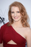 Jessica Chastain opted for a rosy makeup palette on eyes and lips, leaving the color red to her dress and hair.