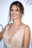 Alessandra Ambrosio's whimsical hairstyle was purposefully mussed, and is a great look for brides to try.
