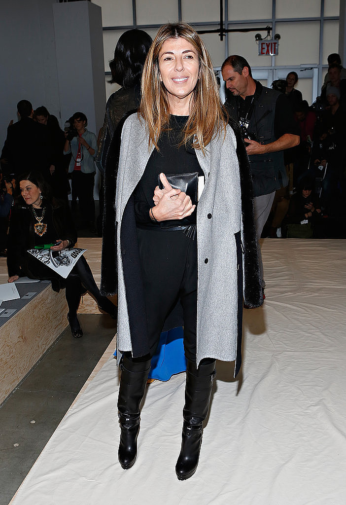 Nina Garcia shows us the easiest trick in the book; wear your coat cape-like, draped over your shoulders.