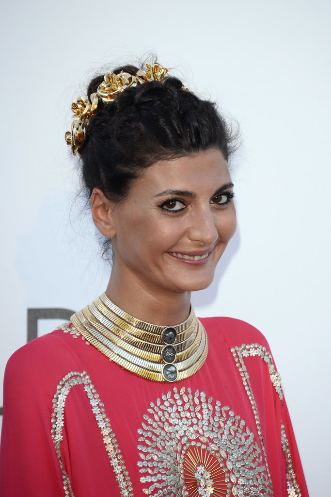 Giovanna Battaglia wore a stacked gold collar and an ornate gold crown.